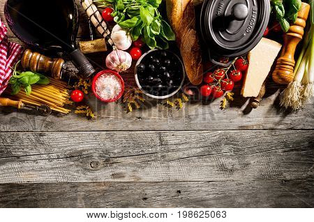 Tasty fresh appetizing italian food ingredients on old rustic wooden background. Ready to cook. Home Italian Healthy Food Cooking Concept.
