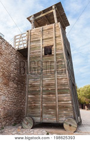 Wooden Roman Siege Tower Near Stone Fortress