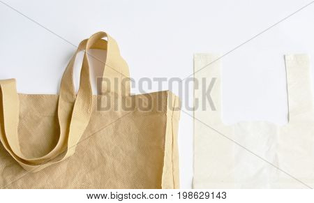 fabric and plastic bag optional for environment concern on white background