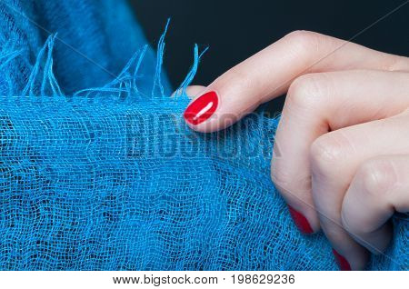 Girl Hand With Feminine Manicure Holding Blue Scarf
