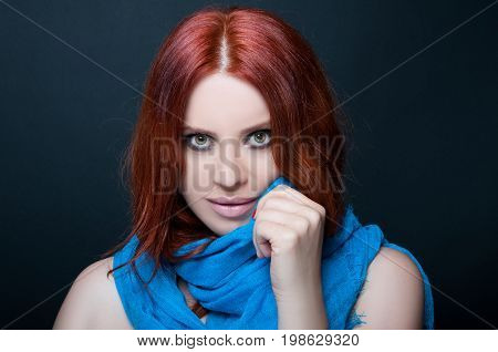 Beautiful Redhead Woman With Blue Scarf