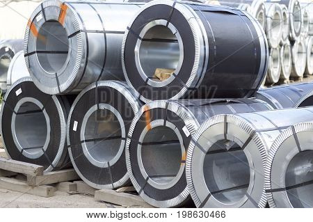 Rolls of cold-rolled galvanized steel with polymer coating in stock poster