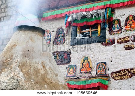 Smoke at praying wall in Lhasa, Tibet close up
