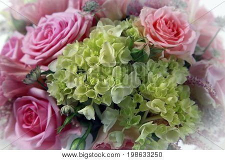 Wedding bouquet from roses and green flowers close up