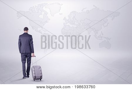Businessman in dark suit planning his trip in a front of a map