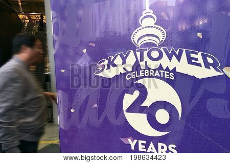 AUCKLAND - AUG 03 2017:Visitor enters Auckland's Sky Tower. The Sky Tower has stood tall at 328 meters as an icon of Auckland's sky line for the past 20 years.