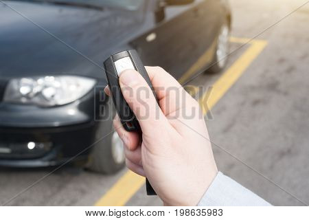 Hand Holding One Car Alarm Key With Anti-theft