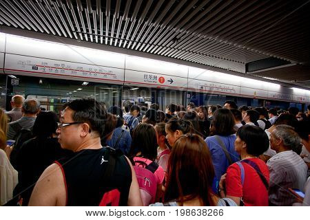 HONG KONG – JULY 14, 2017:  People traveling in the subway. Metro MRT is the most popular form of public transport in Hong Kong.