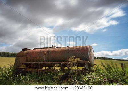 Old Retired Agricultural Machinery Rusting In The Countryside