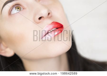 Model girl with bright makeup and red lip rouge