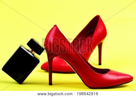 Pair Of Fancy Female Shoes And Perfume, Closeup.