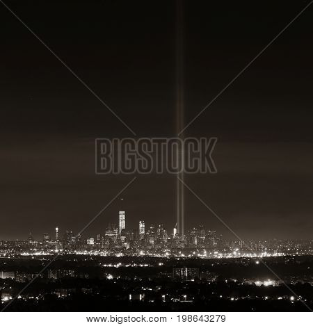 New York City skyline at night with downtown urban skyscrapers and September 11 tribute light