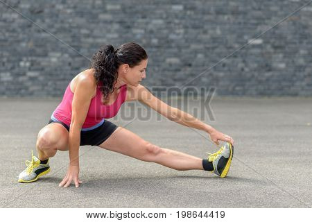 Fit Woman Stretching Her Legs