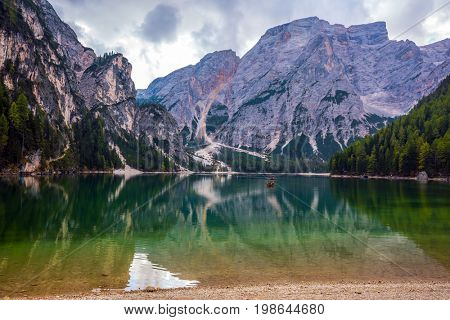 Travel to South Tirol, Italy. Walk around the picturesque lake Lago di Braies. The concept of walking and eco-tourism