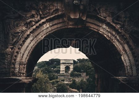 Archway. Rome Forum with ruins of historical buildings. Italy.