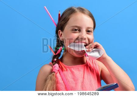 School Girl With Happy Face Isolated On Blue Background
