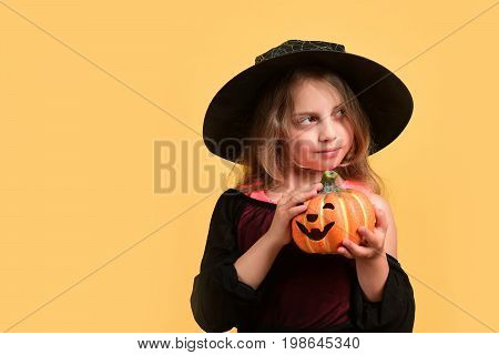 Child In Witch Costume And Jack O Lantern