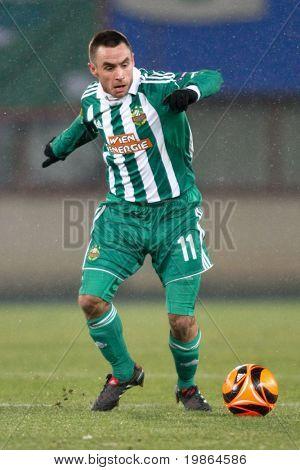 VIENNA,  AUSTRIA - DECEMBER 17: SK Rapid plays 3:3 to Celtic Glasgow on December 17, 2009 in Vienna, Austria. Shown is midfielder Steffen Hofmann (#11, Rapid).
