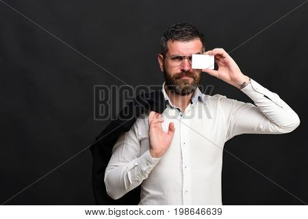 Businessman With Grumpy Face And Glasses On Black Texture Background