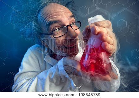 funny scientist, crazy chemist lovingly looking at test tube