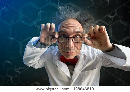 crazy scientist looking thought  glasses in camera