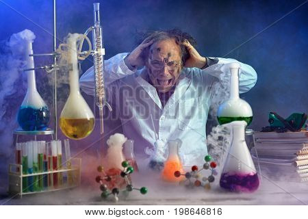 Crazy scientist yelling in his lab front of exploded experiment