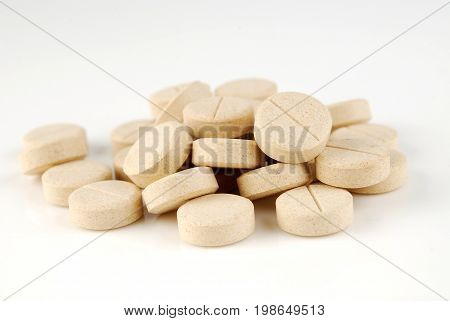 Yellow pills pile, pills pack, medical therapy