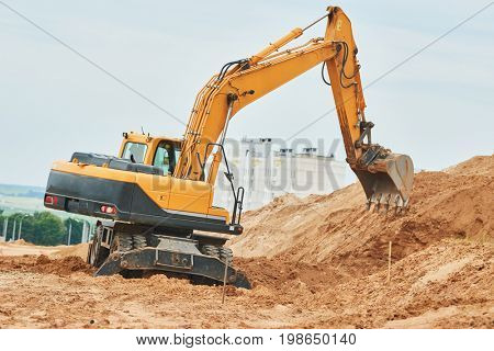 wheel excavator at sandpit during earthmoving works