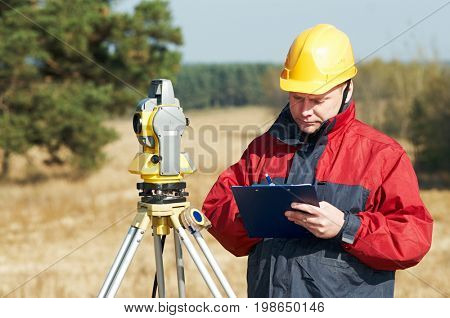 surveyor worker with theodolite
