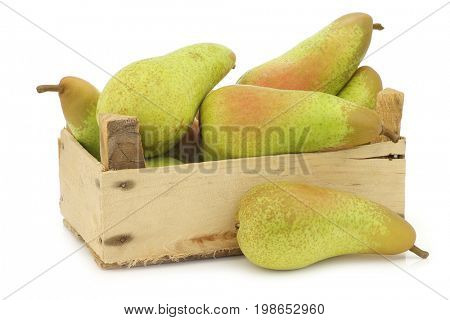 fresh juicy abate pears in a wooden box on a white background