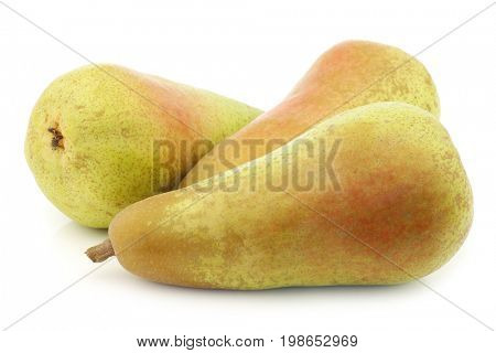 three fresh abate pears on a white background poster