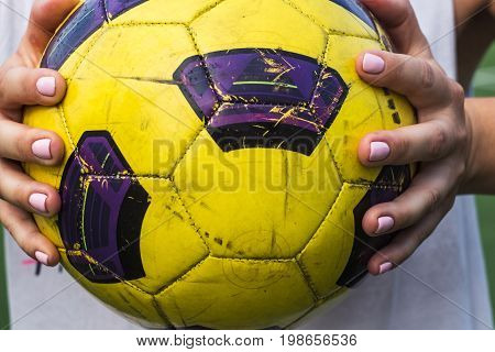 Woman Holding A Soccer Ball In Her Hands