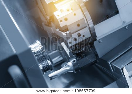 CNC lathe machine (Turning machine) cutting the metal cone shape part .Hi-precision CNC machining concept.