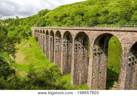Disused Victorian railway viaduct in Smardale, Cumbria, England poster