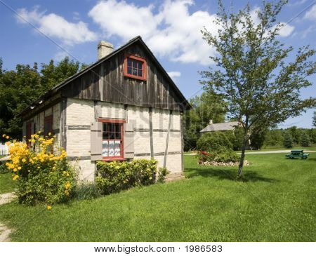 A half timber style home built in the USA by UK homesteaders in 1849. poster