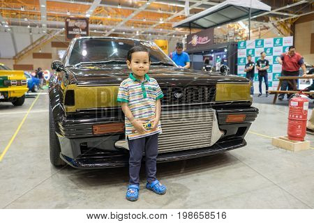 Serdang, Selangor Malaysia - July 29,2017 : Unidentified Young Boy Posing In Front Of Turbocharged N