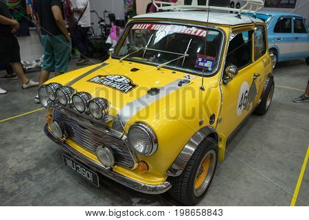 Serdang, Selangor Malaysia - July 29,2017 : Classic Yellow Mini Cooper Car On Display During The Art