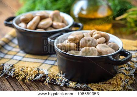Broad Beans Served In Black Bowls.