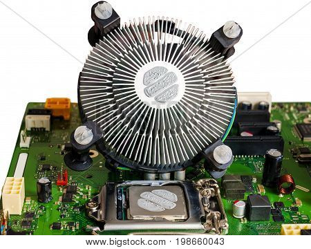 The cooling fan and CPU thermal paste applied before mounting the motherboard