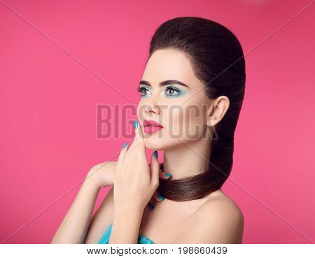 Beauty makeup. Fashion girl portrait. Blue manicured nails. Glamour young woman brunette with eye shadow visage and matte lipstick isolated over pink background.