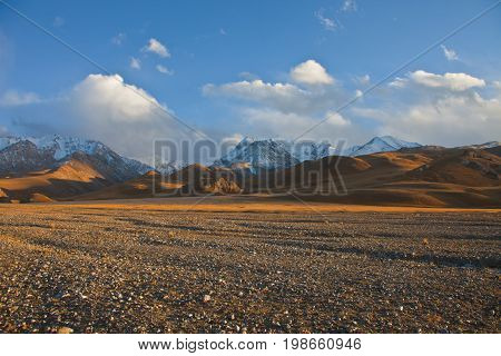 Views of the mountains and pastures of the river valley. The Tien Shan. The Issyk-Kul region Kyrgyzstan