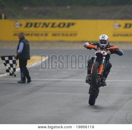 MILAN ITALY JUNE 24 Britains Oliver Pope takes the chequered flag in race 1 of the S3 ec Cup held at the FIM Supermoto World Championship CASTELLETTO DI BRANDUZZO ITALY