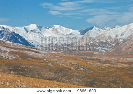 Panorama of ridges and valleys in the fall in the Tien Shan. The Issyk-Kul region Kyrgyzstan slopes steppe snow sky rocks
