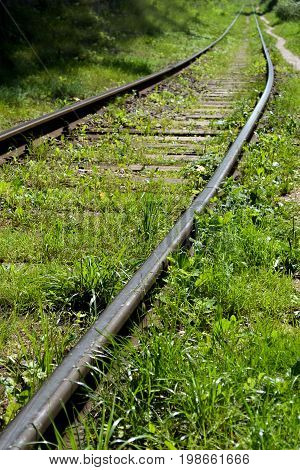 Old abandoned railway overgrown with grass Old abandoned railway