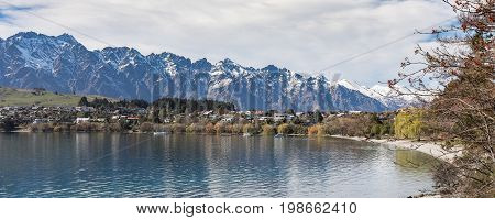 Queenstown South Island New Zealand looking over Lake Wakatipu with The Remarkables in the distance.