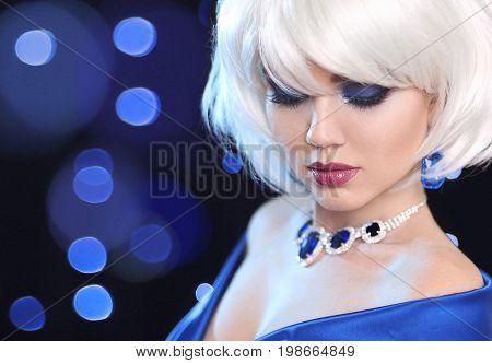 Fashion Bob Blond Girl. White Short Hair. Beauty makeup Portrait Woman. Gems jewelry pendant. Face Close up. Hairstyle. Fringe. Vogue Style.