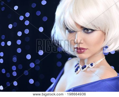 Fashion Blond Girl. Beauty makeup Portrait Woman. White Short Bob Hair. Gems jewelry pendant necklace. Face Close up. Hairstyle. Fringe. Vogue Style.