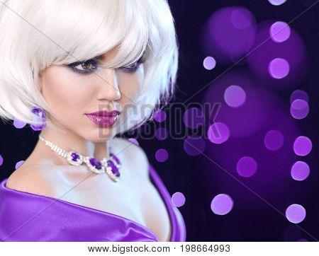 Beauty makeup Portrait Woman. Fashion Bob Blond Girl. White Short Hair. Gems jewelry pendant. Face Close up. Hairstyle. Fringe. Vogue Style.