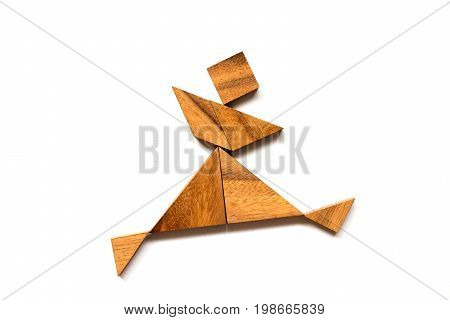 Wooden tangram puzzle in dancing man shape on white background