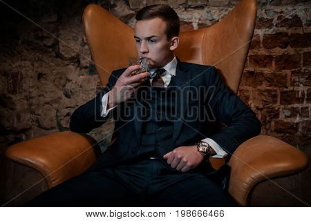 Sharp dressed dandy in a chair